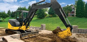 Excavator operating in mud